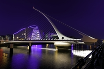 Samuel Beckett Bridge spans River Liffey in Dublin Ireland Designed by Santiago Calatrava