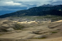 Sand dunes and mountains Great sand dunes Colorado