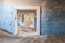 Sand filled house from the ghost town of Kolmanskop Namibia Africa