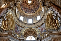 SantAgnese in Agone ceiling interior Rome Italy A th century Baroque church designed by Girolamo Rainaldi and his son Carlo Rainaldi The near-circular interior actually a Greek cross design is circumferentially surrounded by marble sculptural Baroque mast