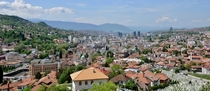 Sarajevo overlooking the city from a cemetery made filled from the Bosnian War OS OC