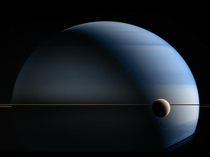 Saturn and its moon Titan in near-infrared processed using methane absorption band data captured by Cassini in May  NASAJPL-CaltechSSICICLOPSKevin M Gill