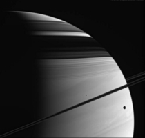 Saturn and its two moons -- Tethys and Mimas