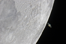 Saturn distance  billion km emerging from behind the Moon distance k km
