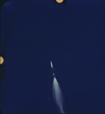 Saturn V Stage Separation During the Launch of Apollo  July th  The Image was Taken with a mm Camera Mounted on the Cargo Door of a US Air Force EC-N Aircraft The Rocket is  Miles Downrange at an Altitude of  Miles