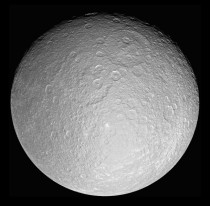 Saturns icy moon Rhea in her full crater-scarred glory