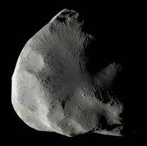 Saturns moon Helene a trojan moon of Dione co-orbital in L- point as seen by Cassini in approximate natural color Data taken in June