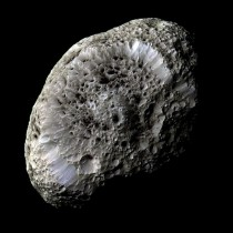 Saturns moon Hyperion A Moon with Odd Craters -- The sponge-textured moon has a density so low that it might house a vast system of caverns inside
