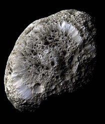 Saturns moon Hyperion resembles a large sponge traveling through space