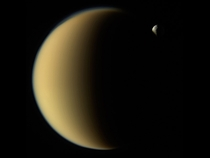 Saturns moon Tethys disappears behind Titan as observed by Cassini on Nov   Credit NASAJPL-CaltechSpace Science Institute