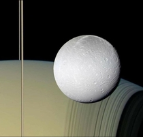 Saturns rings and moon Dione with the atmosphere -- taken by the Cassini spacecraft