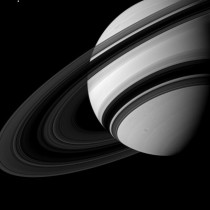 Saturns Rings from the Dark Side  At the top left of the frame is Saturns moon Tethys