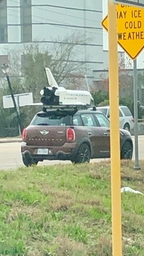 Saw this today near NASA in Houston The space shuttle on top of a Mini Cooper