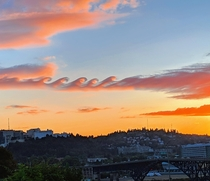 Science says these are Kelvin-Helmholtz clouds but it looks to be like an epic battle between ocean and fire