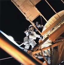 Scientist-astronaut Owen K Garriott Skylab  science pilot is seen performing an EVA at the Apollo Telescope Mount ATM of the Skylab space station cluster in Earth orbit photographed with a hand- held mm Hasselblad camera
