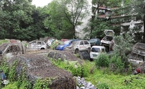 Scrapped vehicles near a residential area in Chengdu China