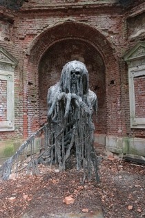 Sculpture of a demon in an abandoned mausoleum in Jelenia Gra in Poland CT