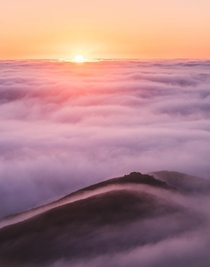 Sea of clouds set ablaze during sunset on the Marin Headlands San Francisco