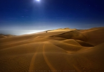 Searching for a bivouac place Namib desert Namibia by Patrick Galibert