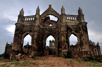 Seasonal monsoons fill the Gorur Dam reservoir and flood the remains this church built on the banks of the Hemavathi River near Hassan India Gurdyal Singh