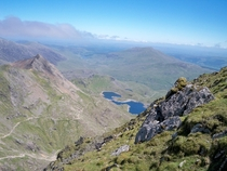Seeing the mighty Yr Wyddfa on the front page inspired me to share one of my own Here is a shot taken from near the peak of Mt Snowdon on a beautiful June day