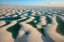Seen from the air the dunes look like white linens hung out to dry on a windy afternoon Lenis Maranhenses Brazil Photograph by George Steinmetz