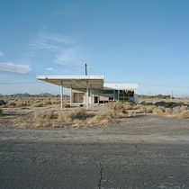 Self Serve Supreme North Edwards CA  Abandoned gas station along hwy  near edwards air force base way out on the roof of the mojave desert bulldozed in