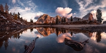 Serene reflecting pool in the Dolomites