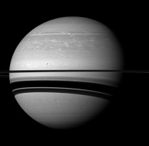 Serene Scene - Saturn and its moon Tethys