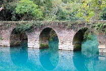 Seven Arches Bridge in Xiaoqikong park in Libo China