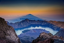 Shadow of mount Rinjani volcano at sunrise Indonesia writes photographer Julien Bo