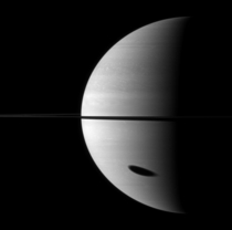 Shadow of satellite Titan approaching the terminator at Saturn Image in near infrared  nm was taken  km away from the gas giant by Cassini space probes wide angle camera on -- credit NASAJPLSpace Science Institute
