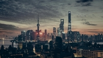 Shanghai at AM by Adi Constantin  - Pollution was low in Shanghai due to everyone being gone for Chinese New Year so I got up at AM to catch this Blade Runner-esque sunrise