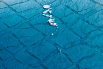 Shards of ice float in a shallow lake atop the Greenland ice sheet east of Ilulissat Daniel Beltra