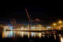 Shipping Container Terminal at night in Hamburg Germany  by Chr Bhm