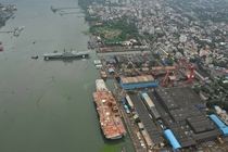 Shipyard at Kochi India featuring two aircraft carriers