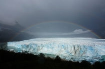 Shitty weather  spontaneous rays of sunshine  Perito Moreno Glacier transforms into magical rainbow glacier