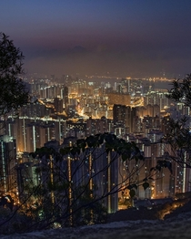 Shortly before sunrise the view over Kowloon from Lion Rock