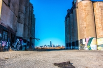 Shot of the Chicago skyline thru the gap of the abandoned Damen Silos in the foreground