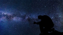 Silhouette Of A Man Under The Stars And Galaxy Image
