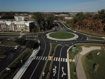 Since  Carmel Indiana a suburb of Indianapolis has replaced almost all of its signalized intersections with roundabouts They have  now and plan to reach