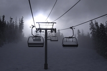 Ski chairlift taking you into the clouds Beaver Creek Colorado By Mabry Campbell