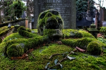Skull Gravestone encrusted in Moss photo by Tunebm on flickr