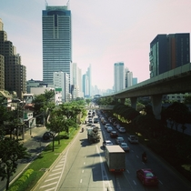 Sky train and main road leading to central Bangkok  OC