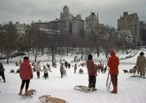 Sledders clamber up a snowy hill in Central Park December   source in comments