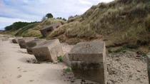 Slowly deteriorating WW coastal defence installations on a beach on Scotlands Moray Coast