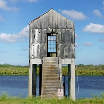 Small pump house on a canal by Lake Okeechobee Florida  album in comments with mechanical pump bone pile and landscape setting
