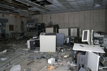Smashed mainframes in an abandoned factory