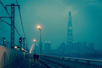 Smoggy evening on the Jamsil Bridge Lotte Tower looming beyond Seoul South Korea