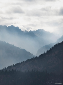 Smoke from a forest fire filling valleys like an early morning mist sawtooth mountains ID